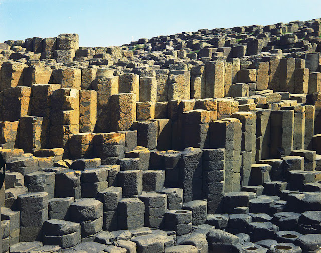 Giant's Causeway. Looking SE. Columnar tholeiitic basalt, showing ball and socket cross-jointing. The cross-joints are upward and downward facing in apparently random pattern. Old photograph number:  NI00706