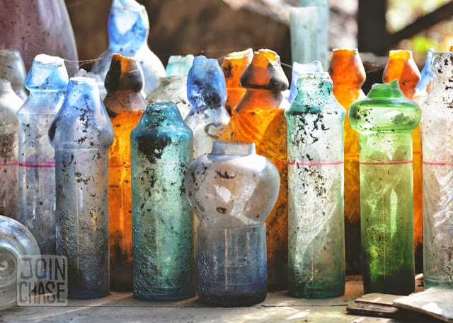 Colorful, broken glass bottles at Nagar Glass Factory in Yangon, Myanmar.