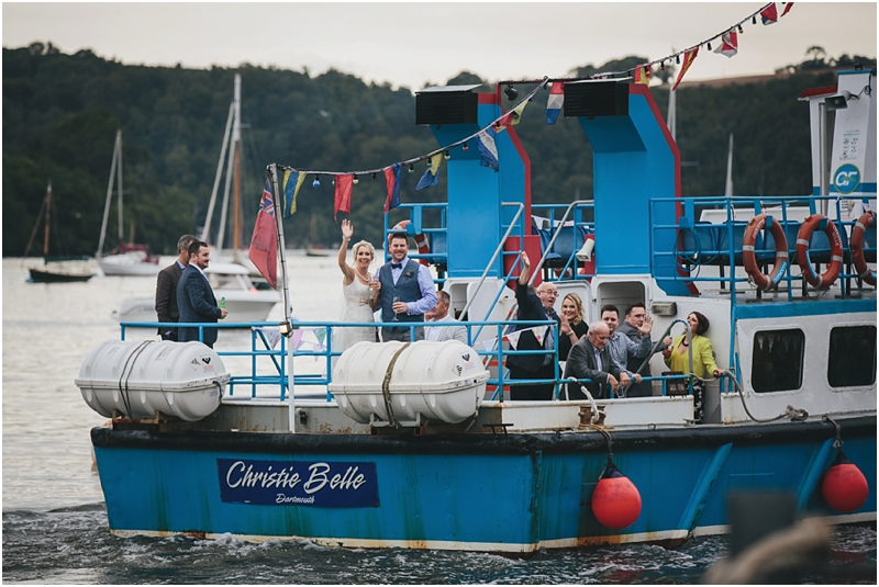 Bride and groom leaving on Christie Belle on the River Dart