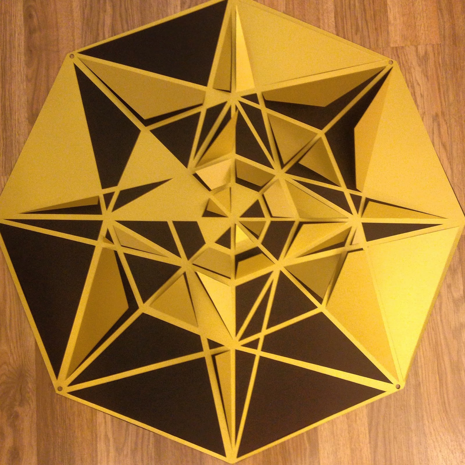 Black and gold geometric papercut wreath