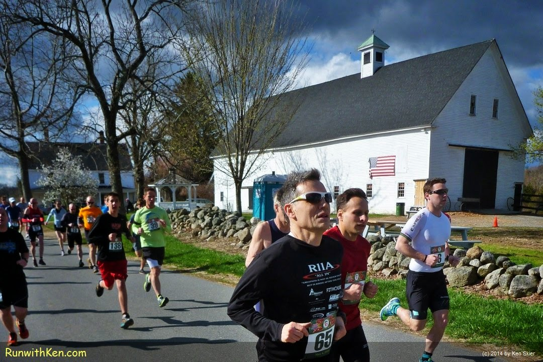 Dramatic up-close photo of runners at a classic New England farm, at the Spring Sprint Duathlon in North Andover, MA. Photo by Ken Skier...the