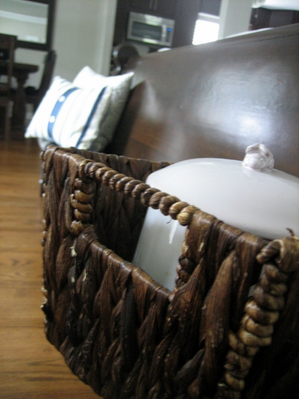 I love how this dark brown wicker basket matches the dark brown stain of the wood on the church pew.