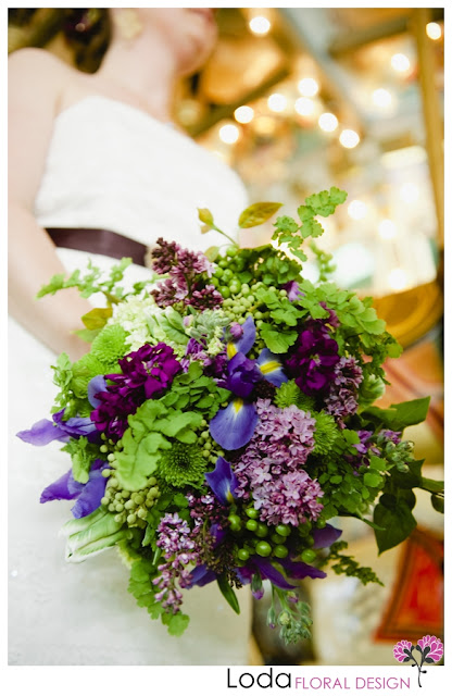 Purple Lilac, purple iris, maidenhair fern, parrot tulips, green hypericum berries