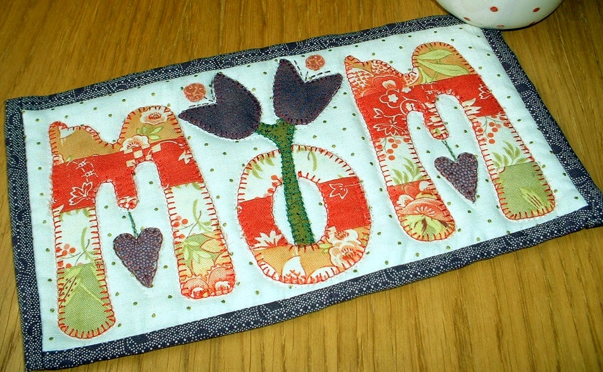 http://www.craftsy.com/pattern/quilting/home-decor/mummom-mug-rug/39163