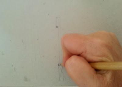 Person drawing a diagram of how windows are built.