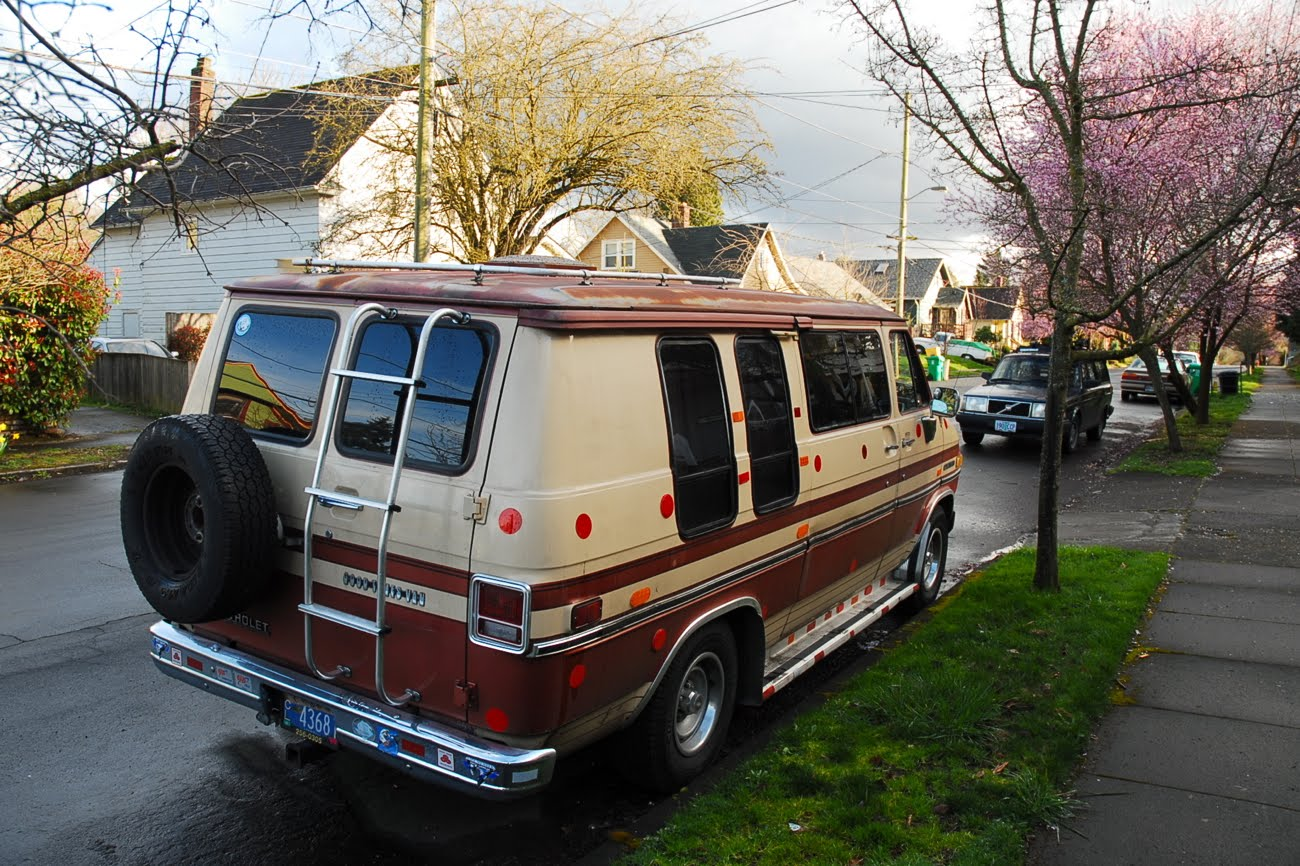 OLD PARKED CARS.: 1983 Chevy Van Good Times Estate.