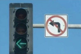 funny sign: traffic light and turn left banned