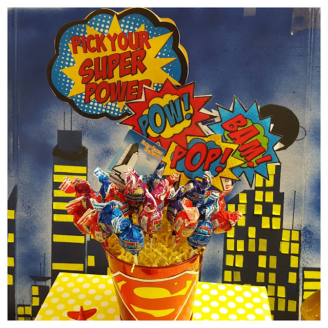 diy superhero centerpiece with cityscape backdrop, eventsojudith