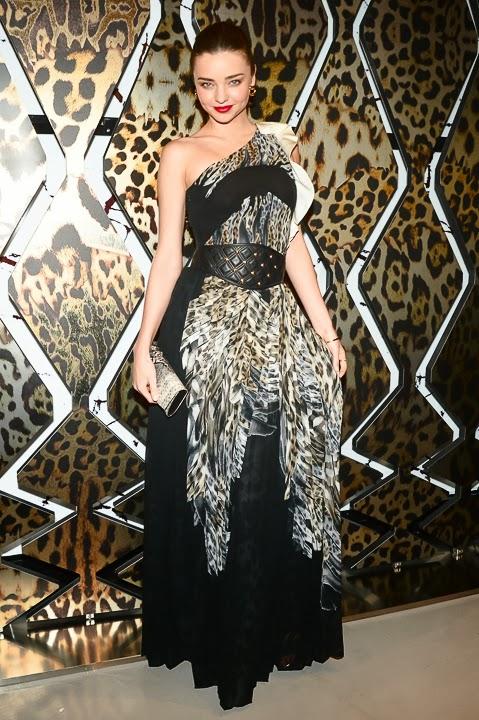 A beautiful designed dress with leather belt on beautiful Miranda Kerr
