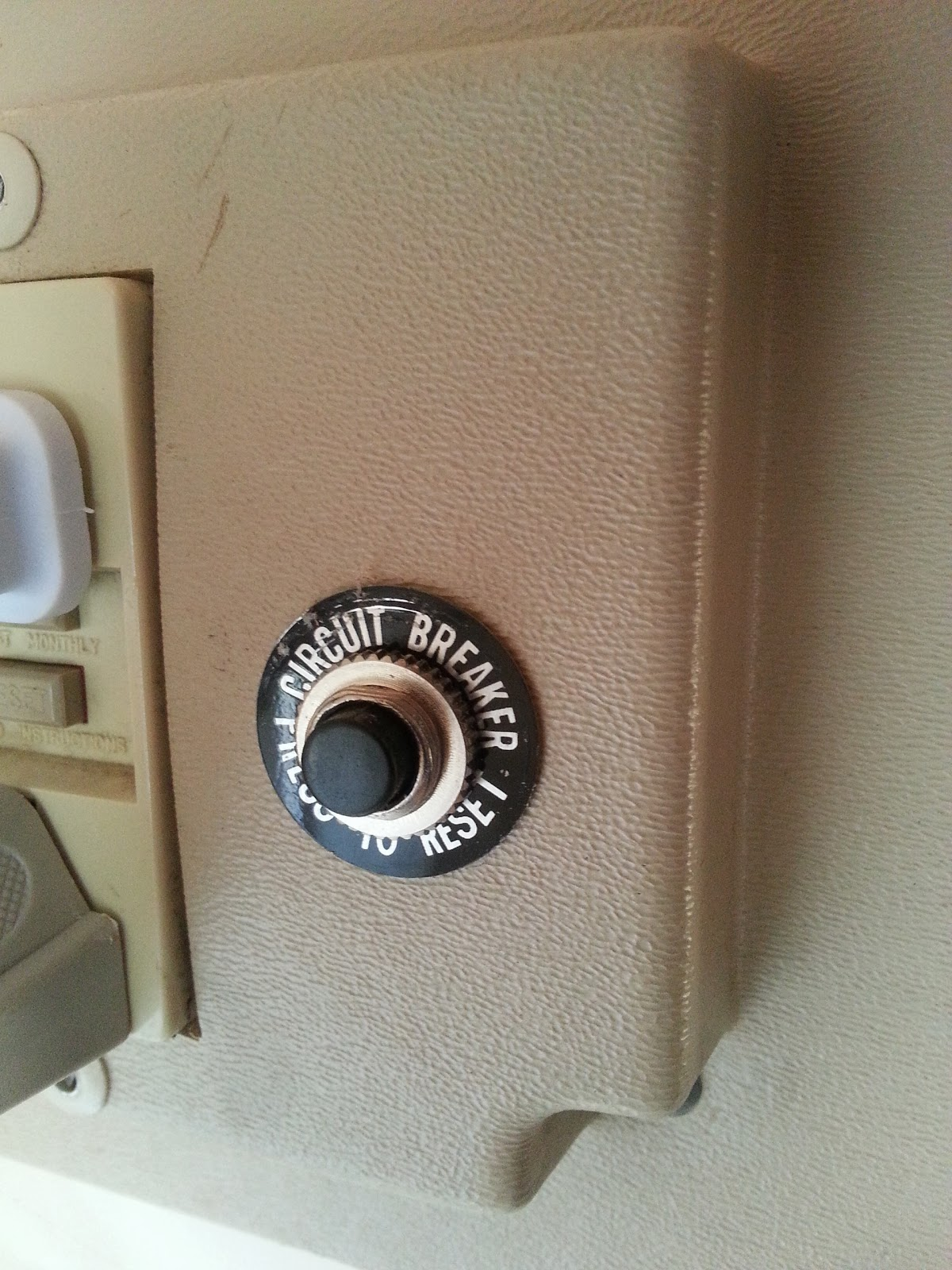 thermal pop-out button circuit breaker on Uhaul CT13 Camper