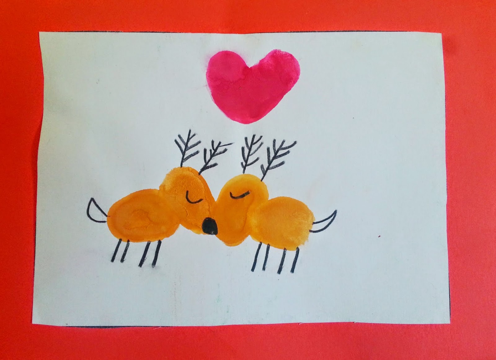 Picture of two sweet reindeer kissing