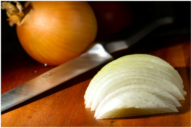 A photograph of a sliced Onion