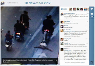 Anderson Cooper photo of Palestinians dragging body behind motorcycle