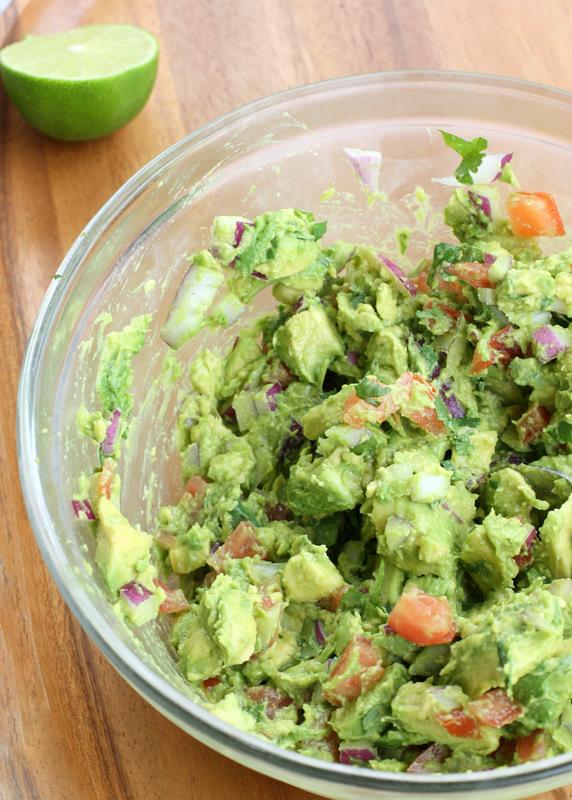 Slightly mash the avocado then add onion, tomato, cilantro, garlic and some ...