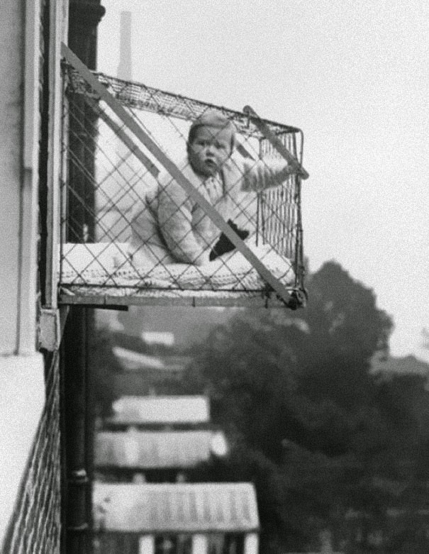 40 Must-See Photos Of The Past - Baby cages used to ensure that children get enough sunlight and fresh air when living in an apartment building, ca. 1937