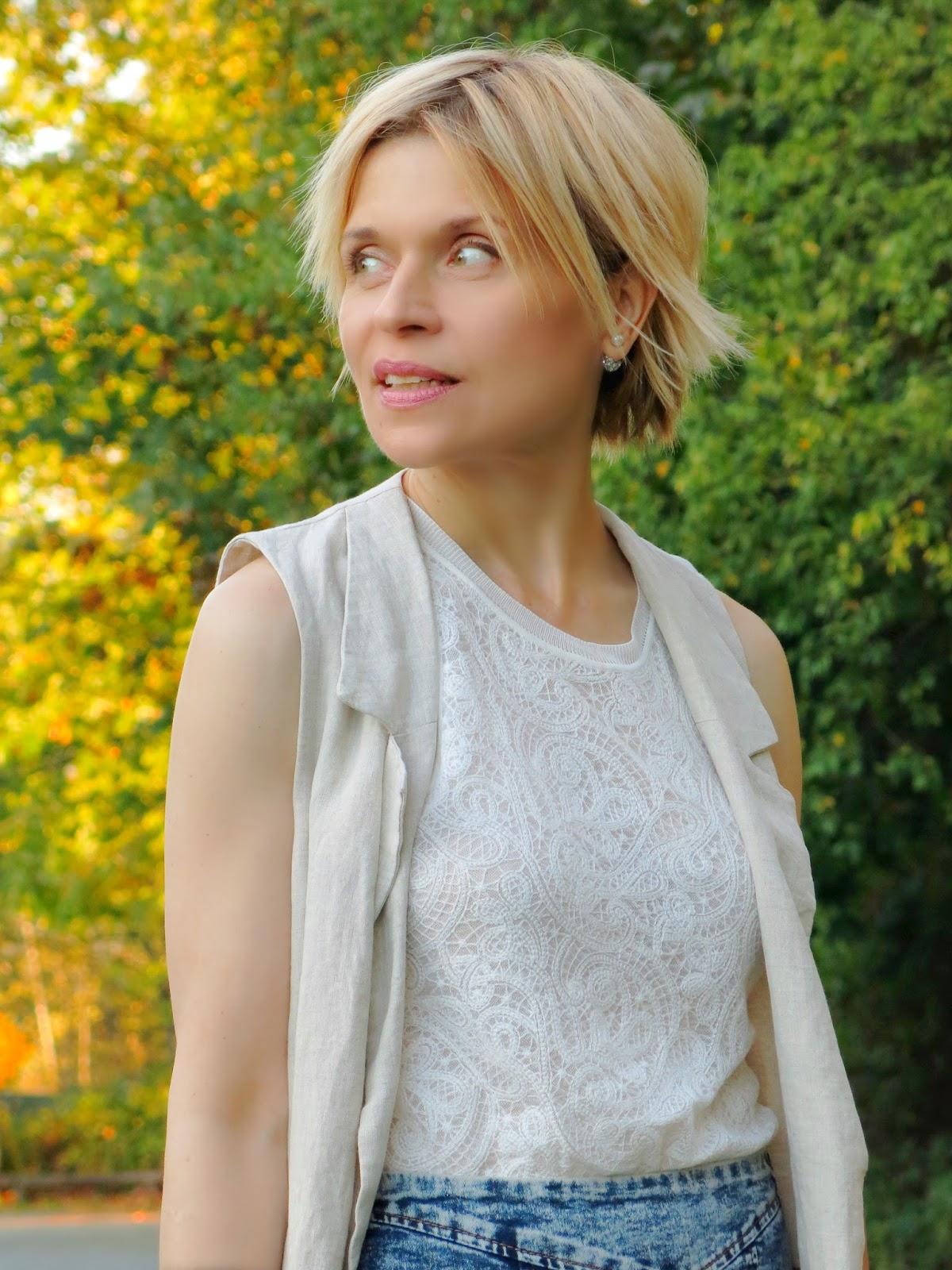 acid-wash denim pencil skirt, lacy top, and sleeveless linen coat