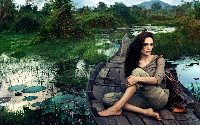 Angelina Jolie with LV Bag on Wooden Boat HD Landscape Wallpaper
