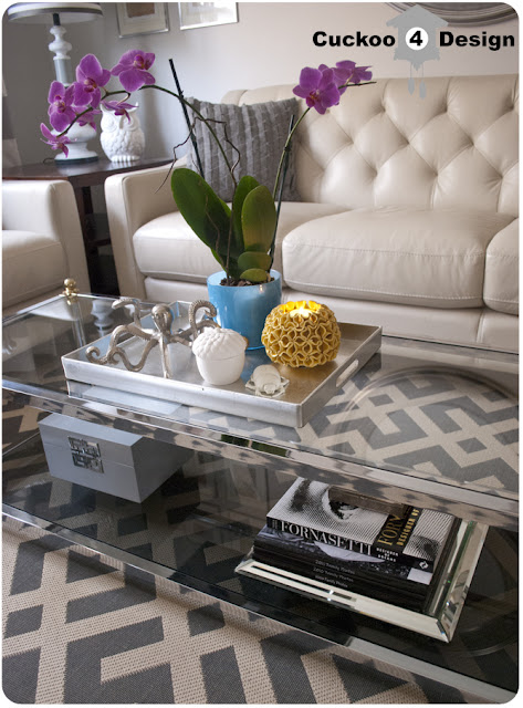 brass and chrome coffee table on grey Overstock rug