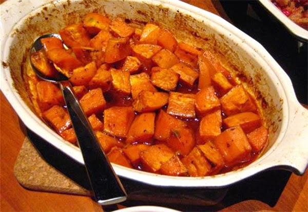 Spicy Honey-roasted Sweet Potatoes: Orange sweet potatoes in a spiced honey glaze.