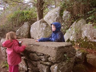 "Children at a stone ""table"""
