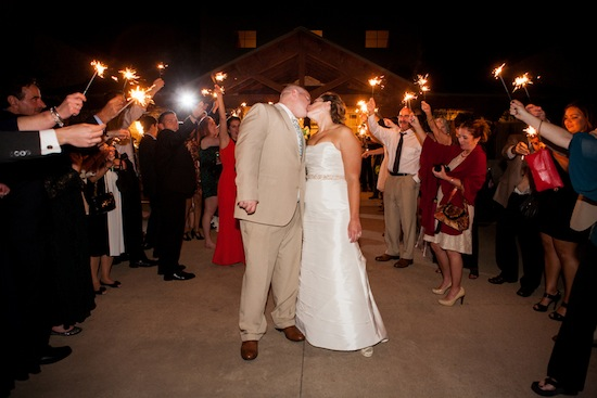 sparkler send off and couple kissing