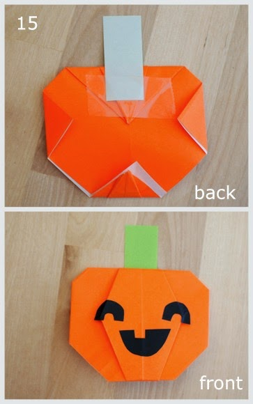 step 15 showing how to fold an origami pumpkin