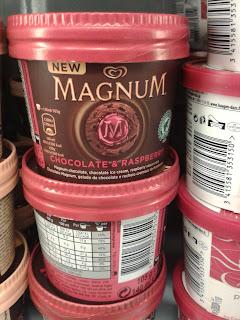 magnum ice cream with raspberry sauce and magnum milk and dark chocolate pieces