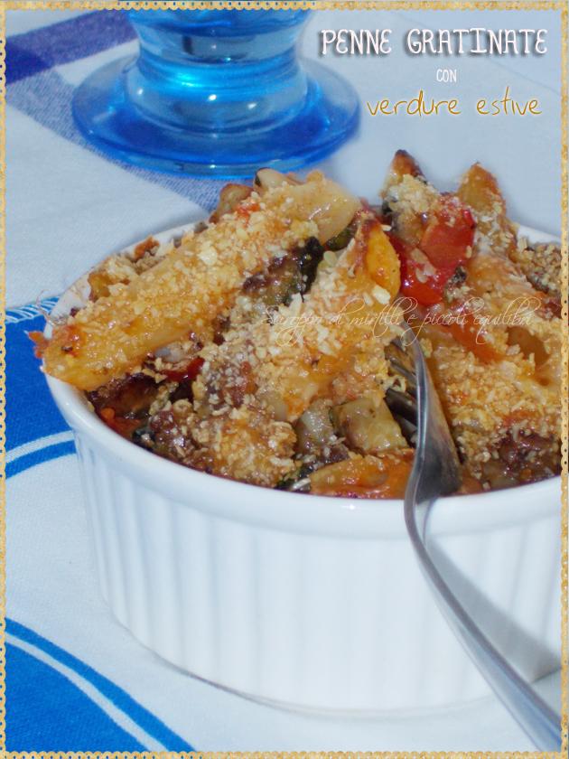 Penne con melanzane zucchine pomodori al forno gratinati