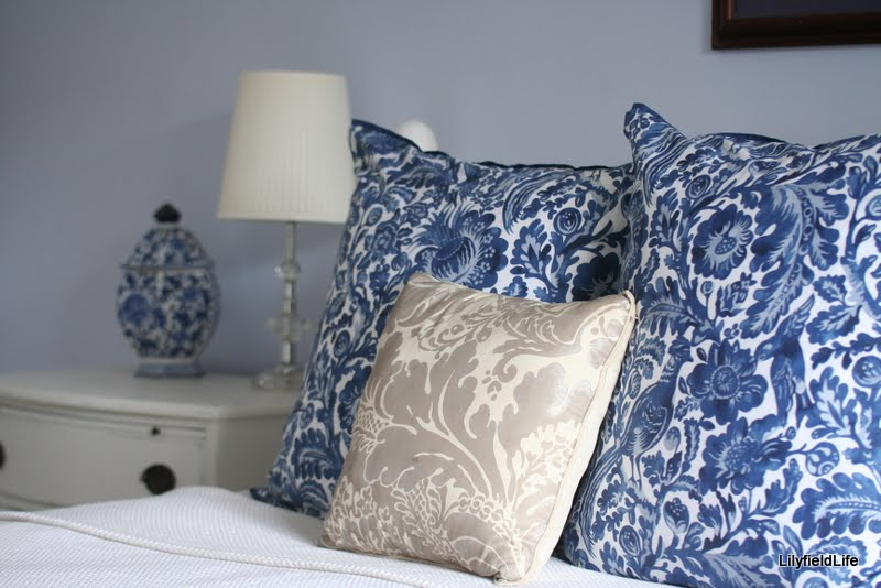 white linen and furniture with blue and white accents in cushions