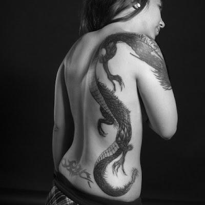 Black Tribal Dragon Tattoos