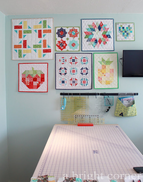 Wall of mini quilts