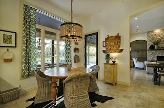 traditional and ocean inspired dining room with unique wooden pendant lights