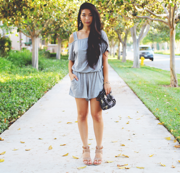 Stephanie Liu of Honey & Silk wearing SaVous romper, Chloe + Isabel jewelry, Urban Outfitters bag, and Herve Leger heels