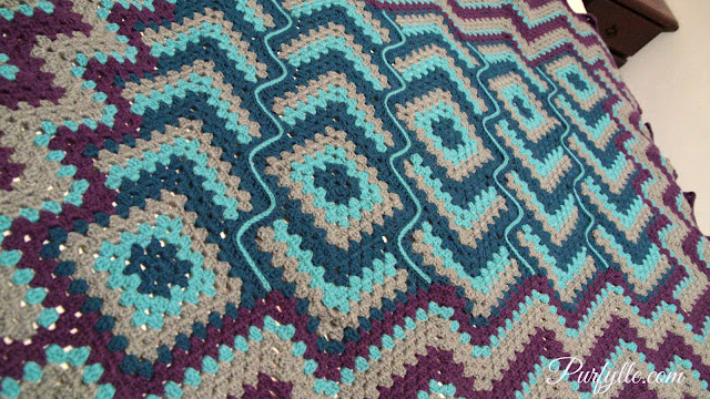 Drops in the Frog Pond crochet afghan. All the 'drops' are in a row just as if a frog and leaped and left a trail of droplets.