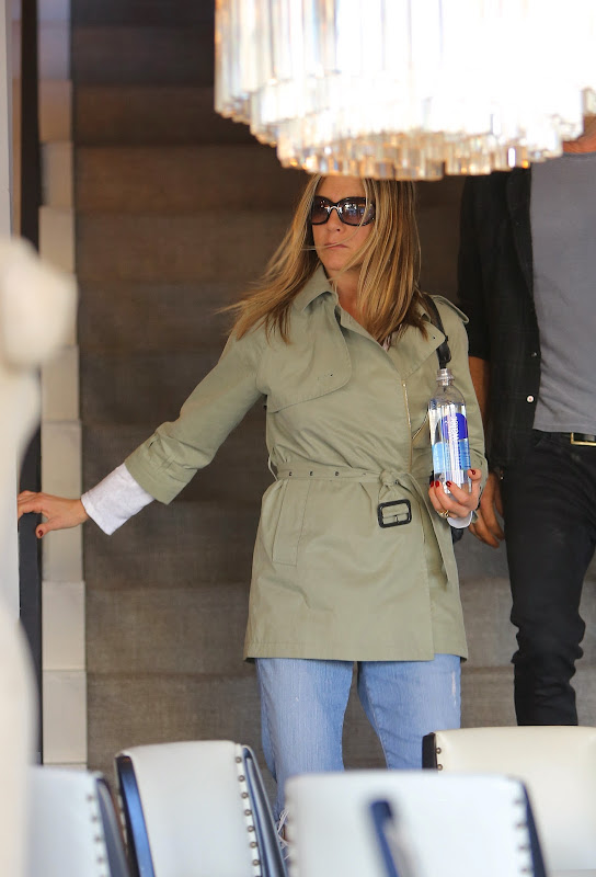 Jennifer Aniston in jeans and a coat
