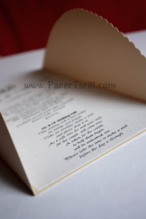 Handmade red ribbon gate-fold wedding card