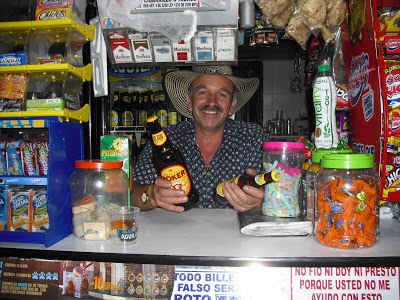 Service with a smile. Our local barman dishing out the booze