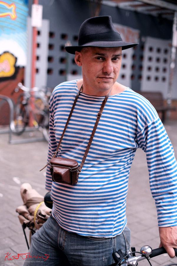 Street Fashion Sydney - Peter, Fedora Hat, Bike & Camera - Newtown. Fuji X-Pro1