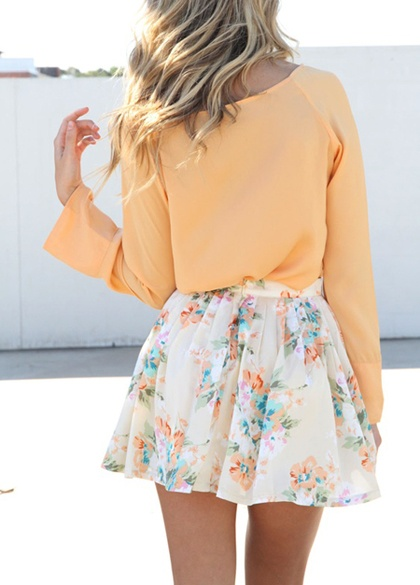 Light orange blouse and flowery skirt for ladies