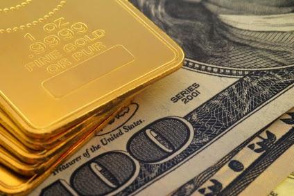 صعود الدولار وانخفاض الذهب والفضة لأدنى مستوى في 4 سنوات