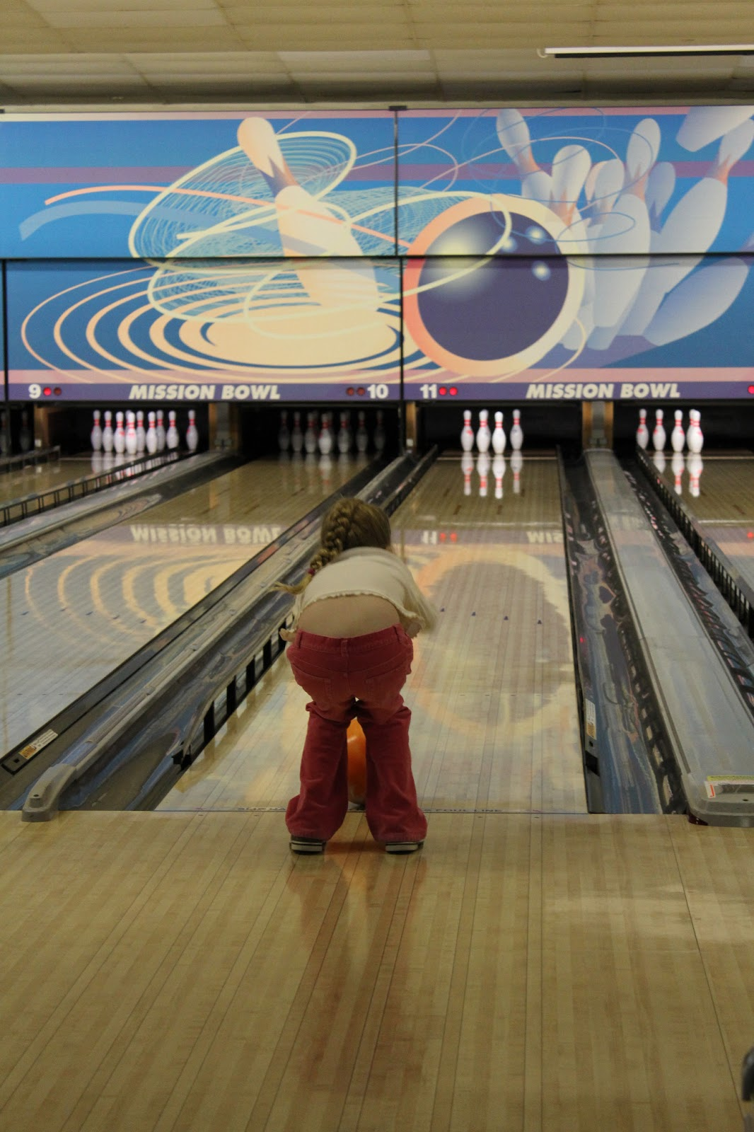 This bowling alley doesn't have the cool ramps that they other one did. So  Edee had a harder time doing it herself. Papa was there to help her get the  ball ...