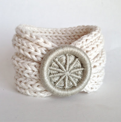 Dorset button on knitted cuff