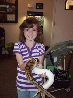 My daughter with a friendly Ball Python named Woodstock!