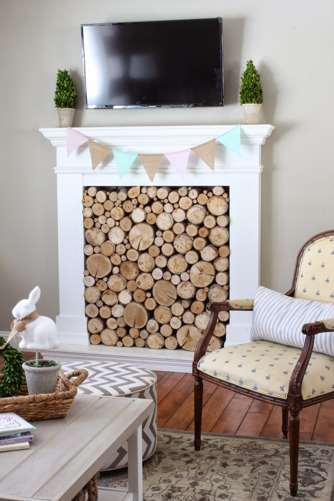 Spring Easter banner on faux fireplace from Target Dollar Spot-www.goldenboysandme.com
