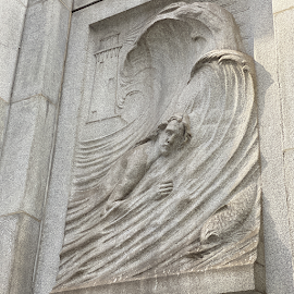 Water Works Bas-Relief by John Flanagan represents the spirit of the waters.