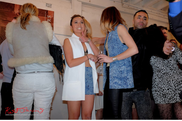Happy fashion designers at a successful launch party. Photography by Kent Johnson.