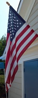 american flag hanging of building