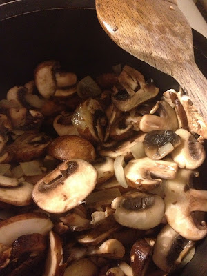 cooked chestnut mushrooms in pan