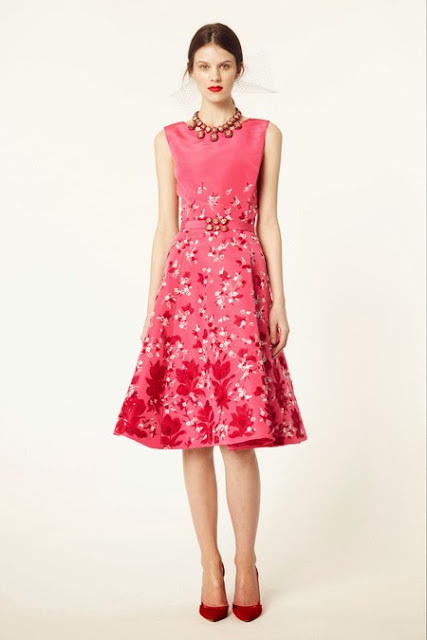 Model wearing a pink dress from Oscar de la Renta's 2014 Resort Collection