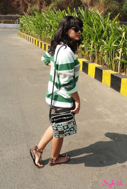 The personal style of Dayle Pereira who is the blogger at Style File includes an Adidas Originals striped pullover knit, Espirit shorts, Montego Bay Sandals and a Nightmare Before Christmas sling bag for a relaxed day out